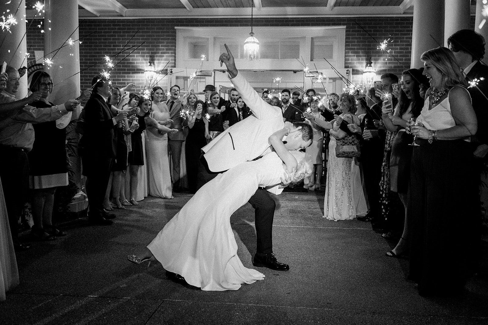 Sparkler exit with groom dipping his bride at the Fox Chapel Field Club