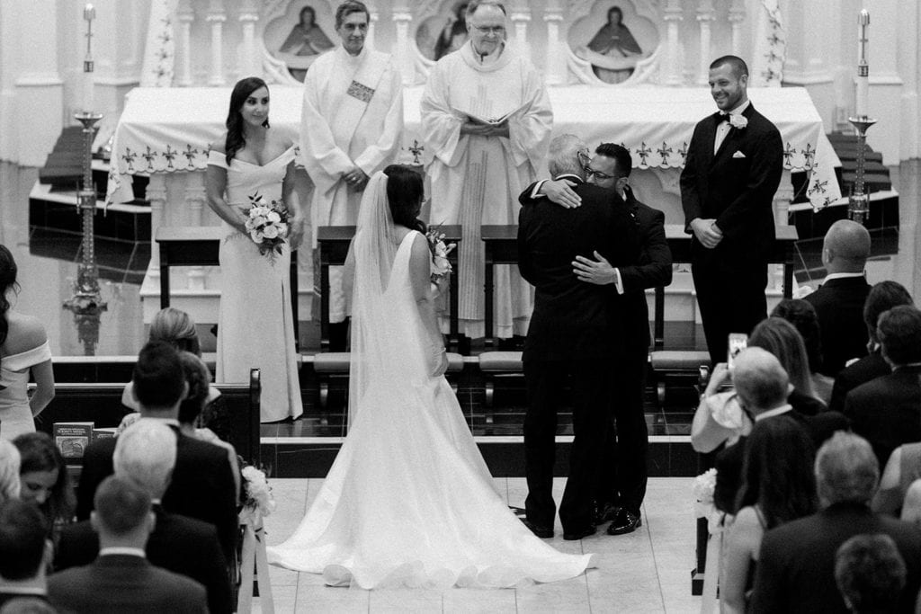 Father of the bride giving his daughter away at St Peter's Parish