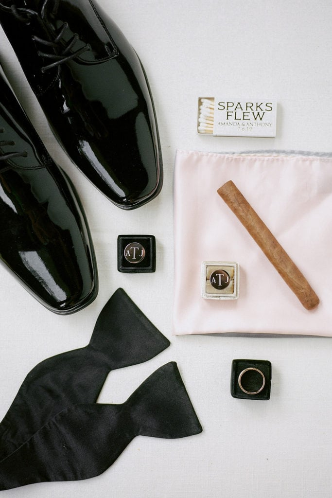 Groom's details with pink pocket square and cigars