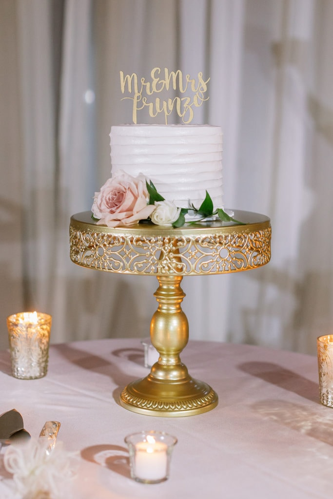 Wedding cake from Oakmont bakery with gold topper