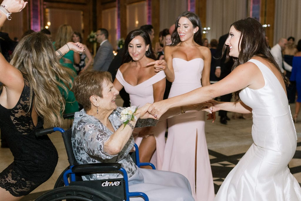 Wedding guests dancing with grandma inside the Pennsylvanian