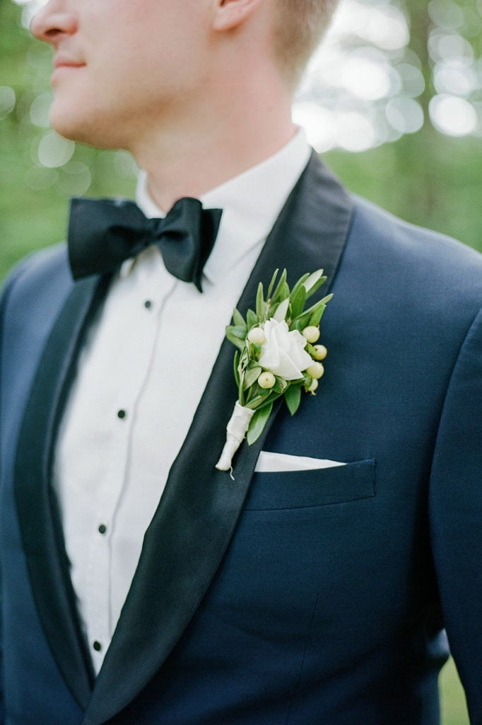 close up of grooms tux and boutonnière