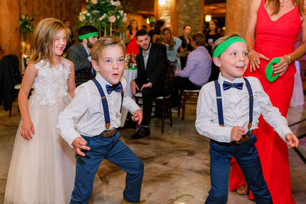 Children and guests dancing at wedding reception