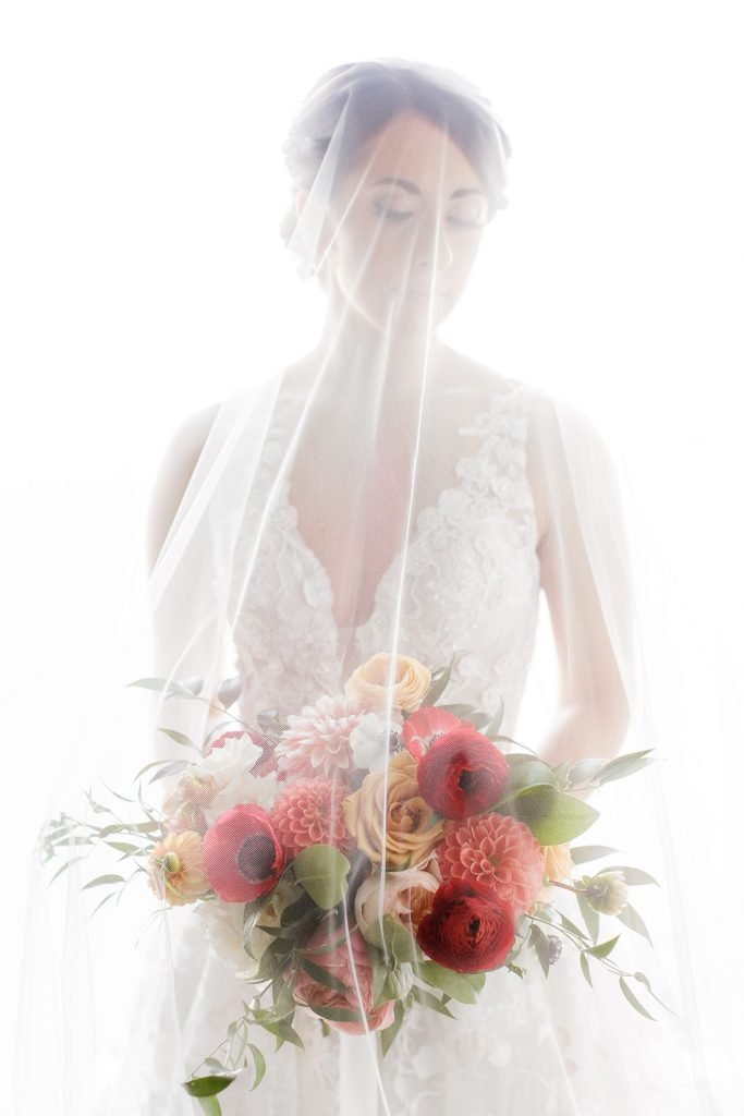 Bridal portrait with bouquet by Sapphire and Lace captured by Pittsburgh wedding photographer Lauren Renee