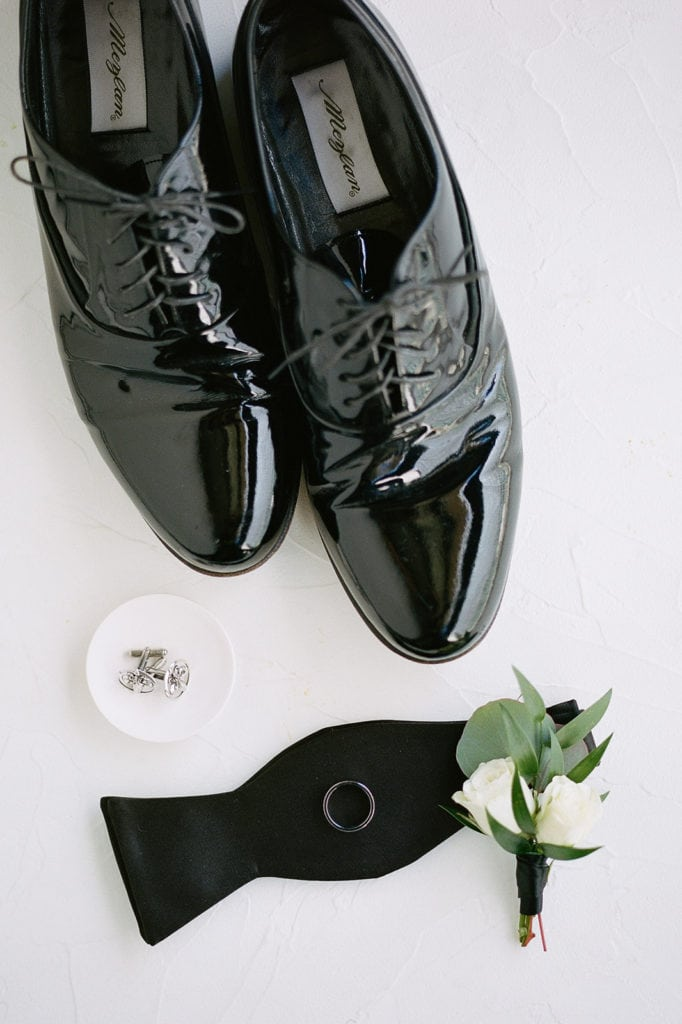 Groom's wedding shoes and white wedding boutonniere