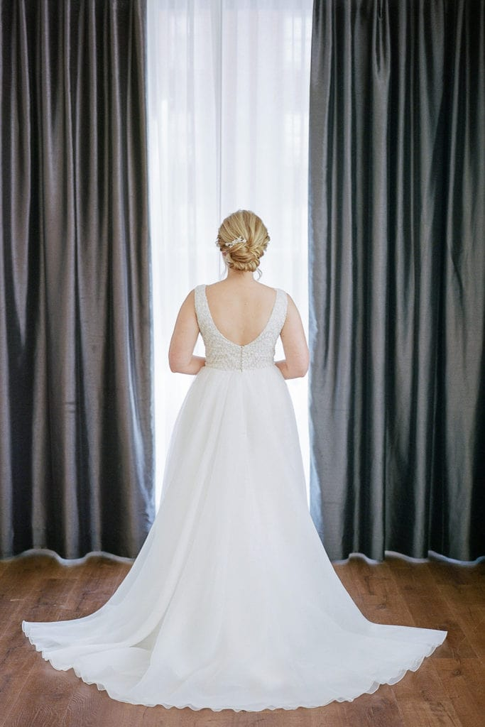 The back of a daalarna couture wedding dress on a bride