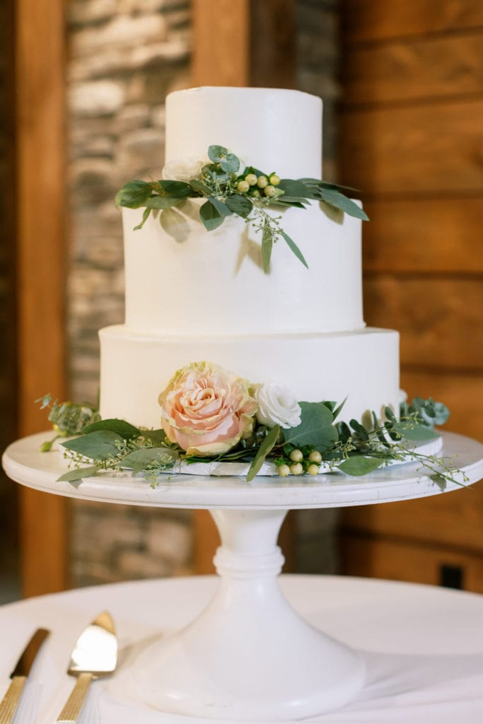 White and greenery wedding cake: Outdoor Fall Seven Springs Wedding captured by Pittsburgh Wedding Photographer Lauren Renee