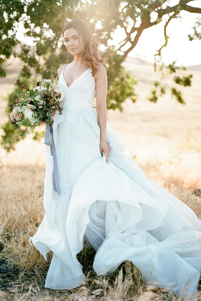 Carol Hannah Bridal Dress Ceremony Arch with flowers by Emily Reynold Design: Kestrel Park California Wedding Inspiration Styled Shoot captured by Pittsburgh Wedding Photographer Lauren Renee