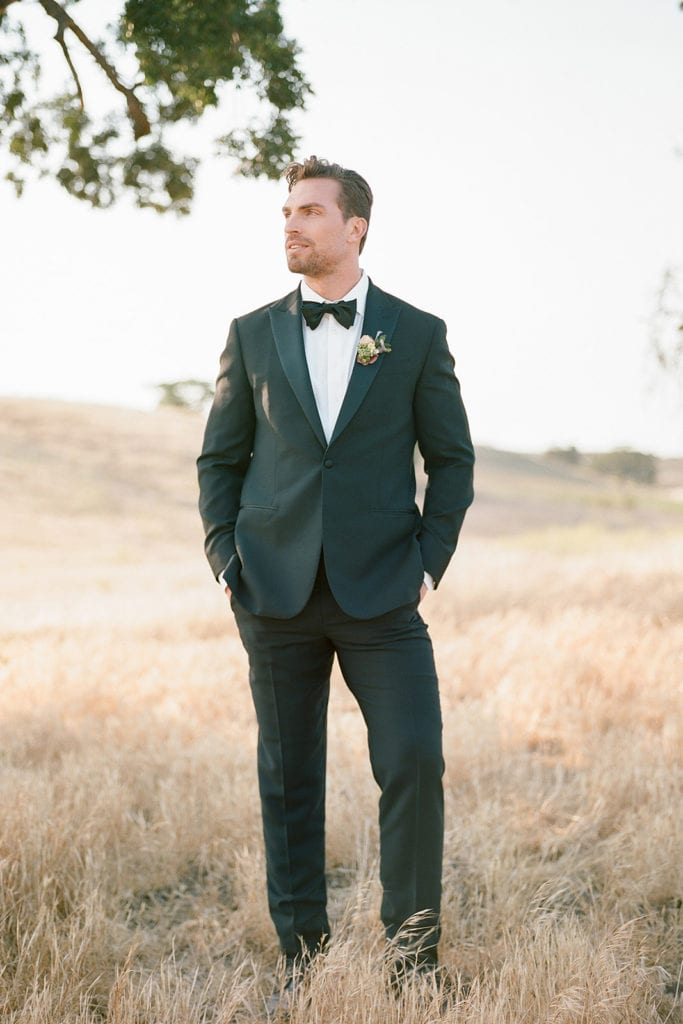 The Black TuxCeremony Arch with flowers by Emily Reynold Design: Kestrel Park California Wedding Inspiration Styled Shoot captured by Pittsburgh Wedding Photographer Lauren Renee