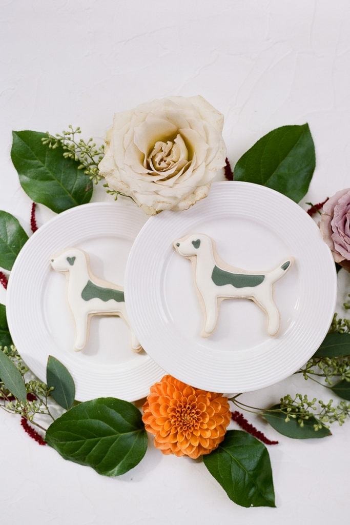 Homemade cookies in the shape of a sheep dog as party favors