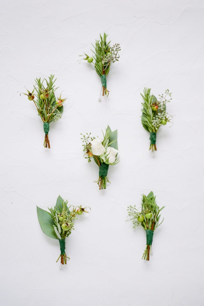 boutonnières for the groom and his groomsmen from the farmer's daughter flowers