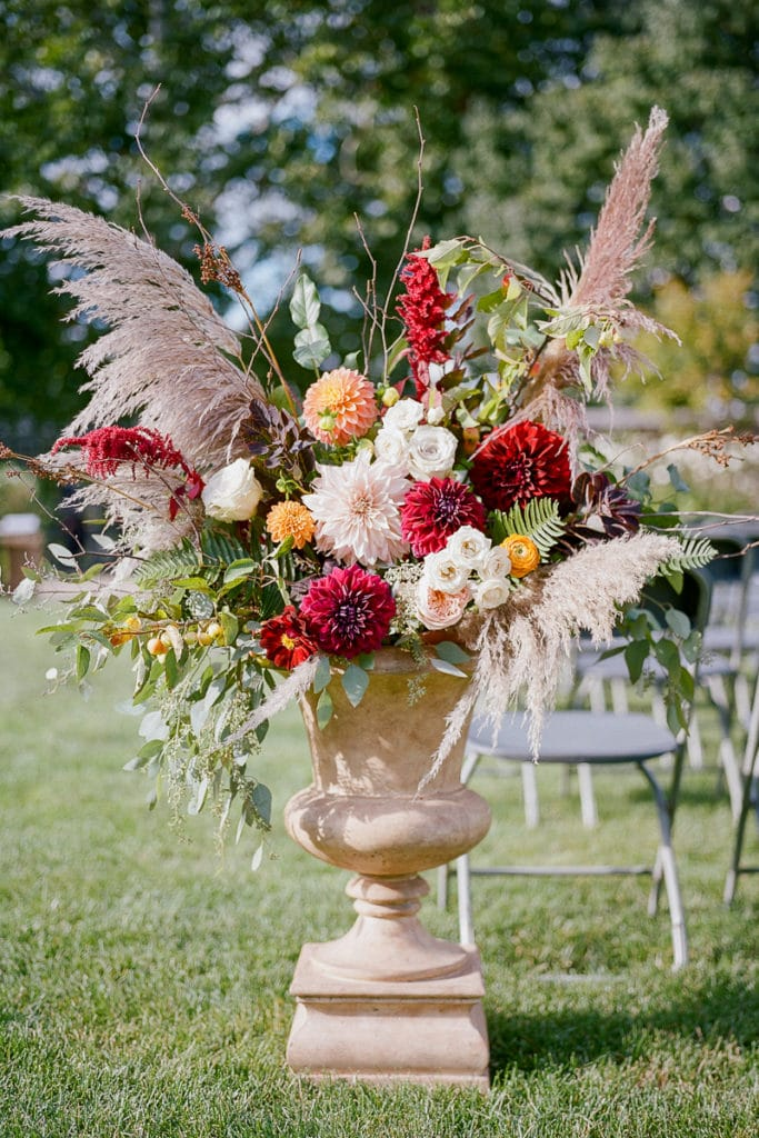 Flowers urns with red and orange color palette from the Farmer's Daughter Flowers