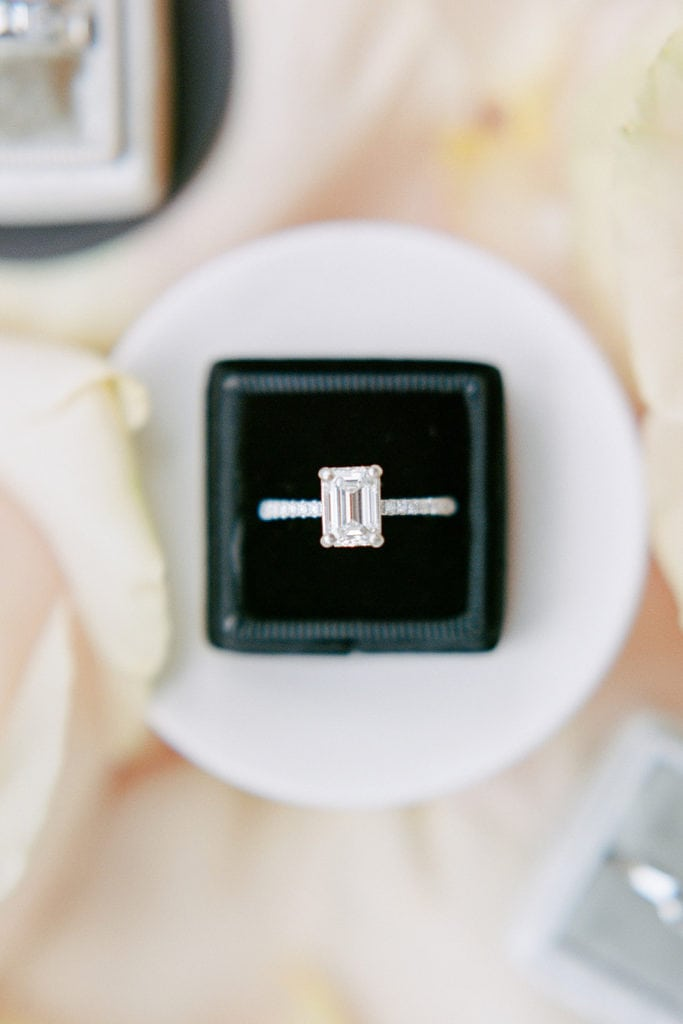 Close up of engagement ring in a black mrs. box