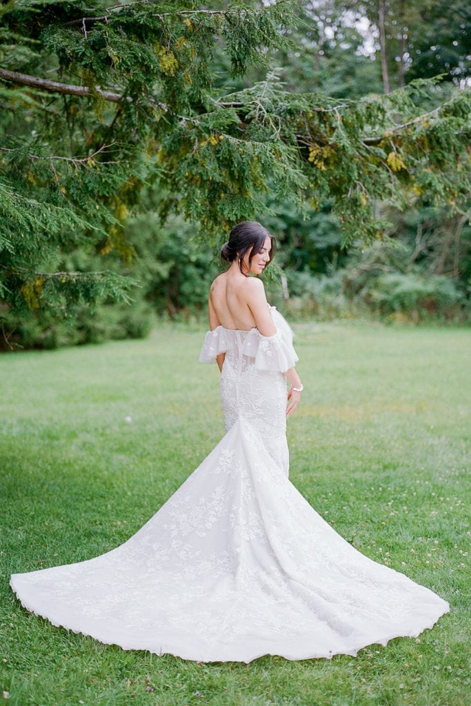 Bride in her Berta Bridal Gown outside