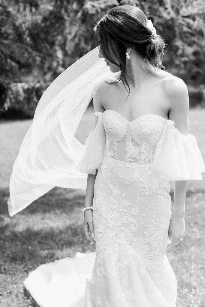 Bride getting into her Berta Bridal Dress