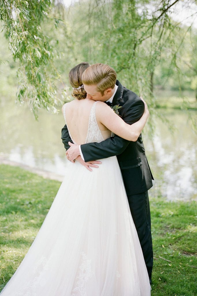 Bride and groom hugging during first look: How to Choose a Wedding Photographer by Lauren Renee