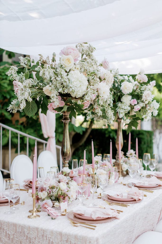 Pretty in pink table decor with high center pieces at Phipps Conservatory garden