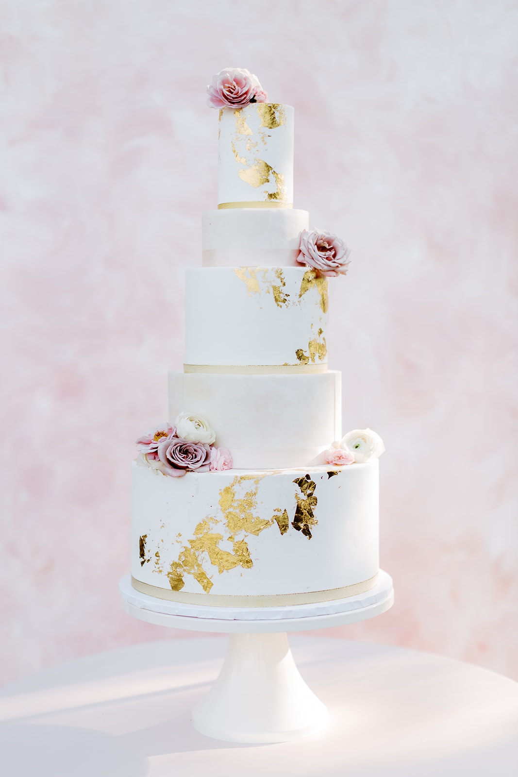 Tasty Bakery three tiered wedding cake with Lindale Studios pink backdrop