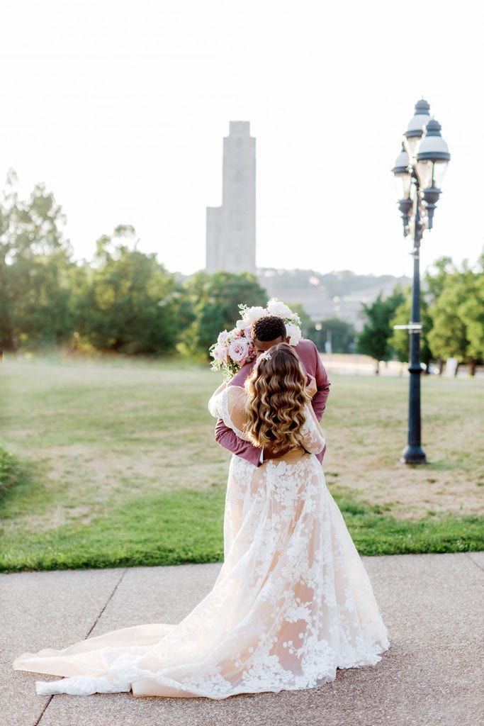 "Bride and groom kissing in front of Phipps with the Cathedral of Learning in the background: ""Pretty in Pink"" Wedding Inspiration"