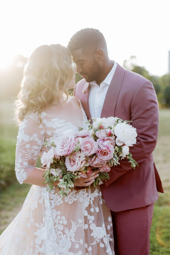 Bride and groom romantic portraits outside of Phipps Conservatory wedding venue at sunset