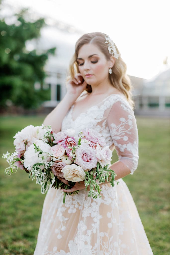 Bridal portrait in front of Phipps conservatory at sunset