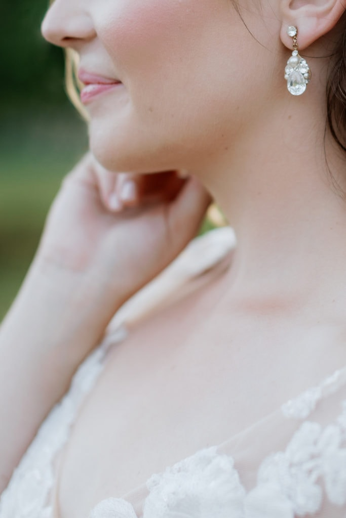 Close up photograph of bride's neck and earrings