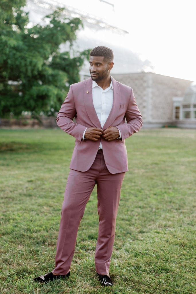 Groom wearing mauve tux from the Black tux