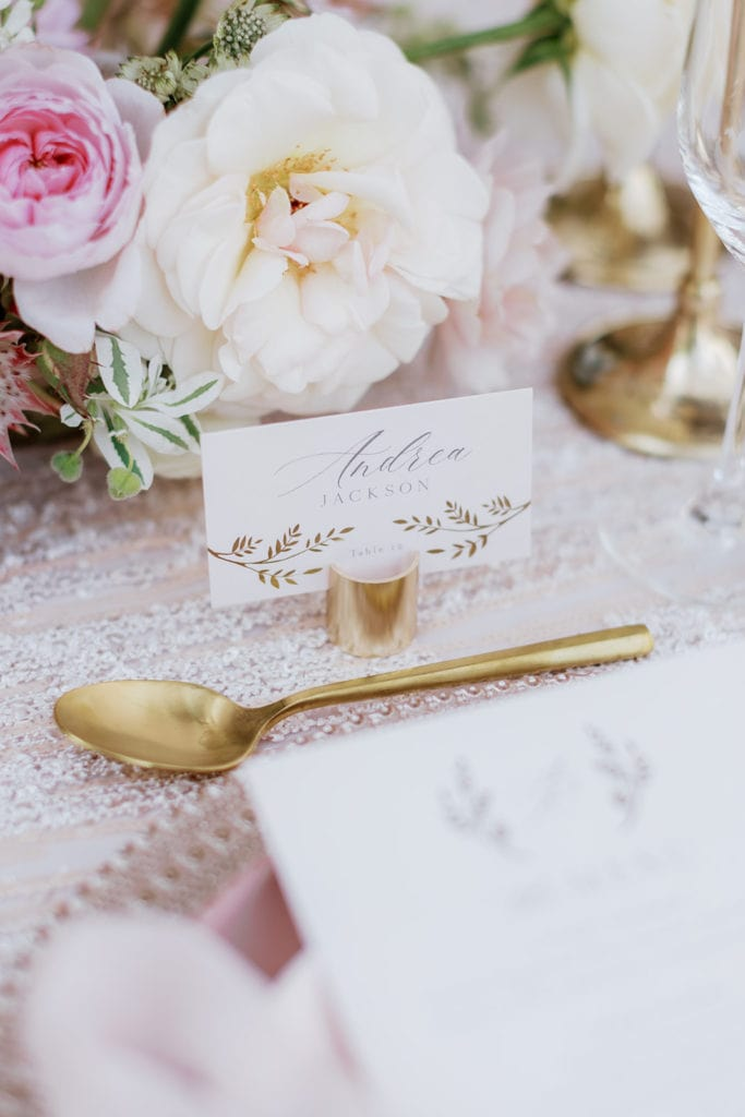 Escort cards from minted with gold place holder and gold flatware