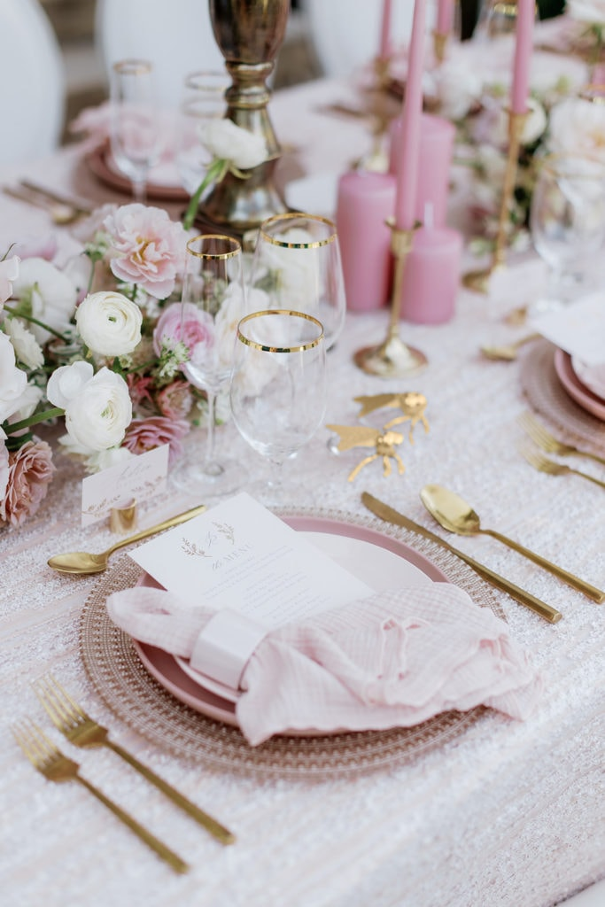Pretty in Pink table decor with pink mosaic linens and gold rimmed glassware