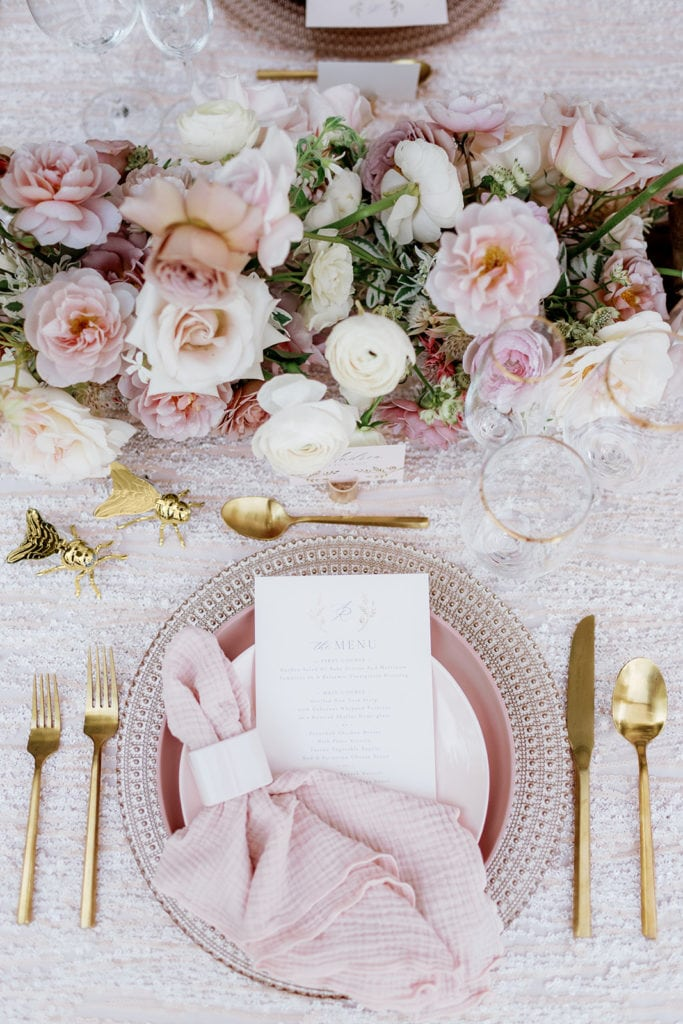 "Place setting with pink charger and dishes with gold flatware and bumble bee salt and pepper shaker: ""Pretty in Pink"" Wedding Inspiration"