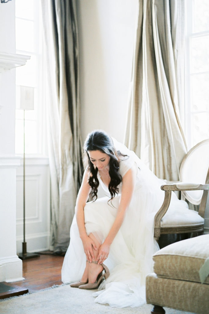 Bride putting on her Manolo blahnik shoes and watters dress at Zero George St. Hotel in Charleston: What I learned from my own wedding