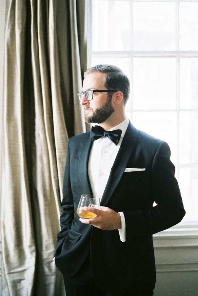 Bonobos tux and tie bar accessories groom holding a glass of whiskey: 5 things i learned from my own wedding
