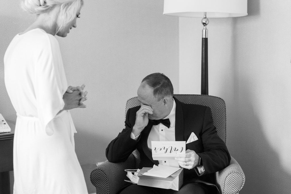 Bride giving her father a gift on her wedding day