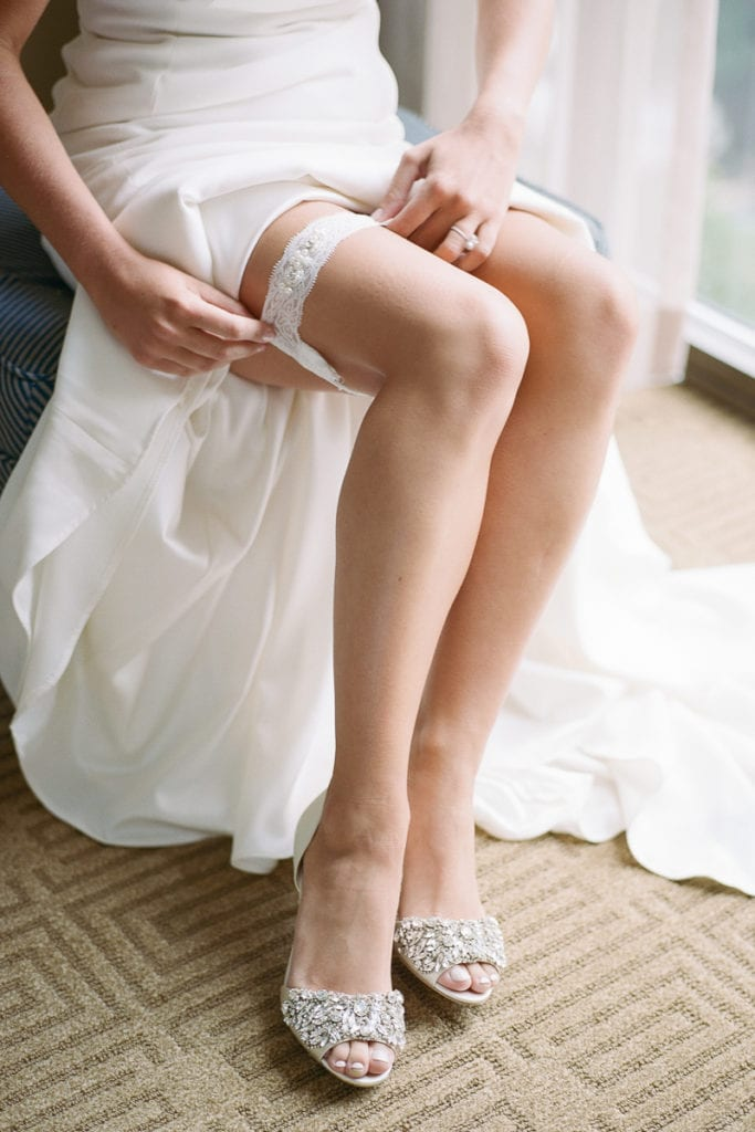 Bride putting on her wedding garter