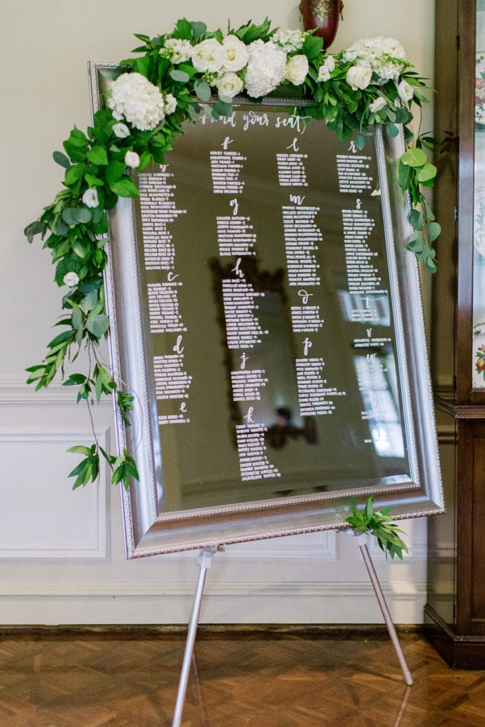 Mirror display escort cards with flowers