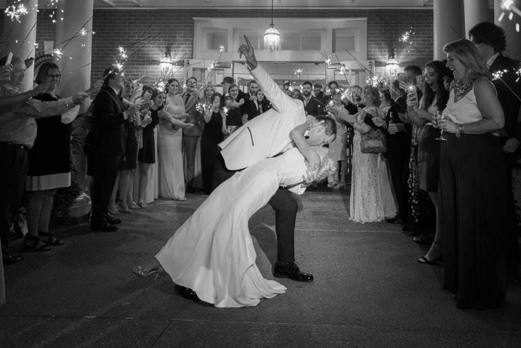 Bride and groom exiting their wedding with a sparkler send off