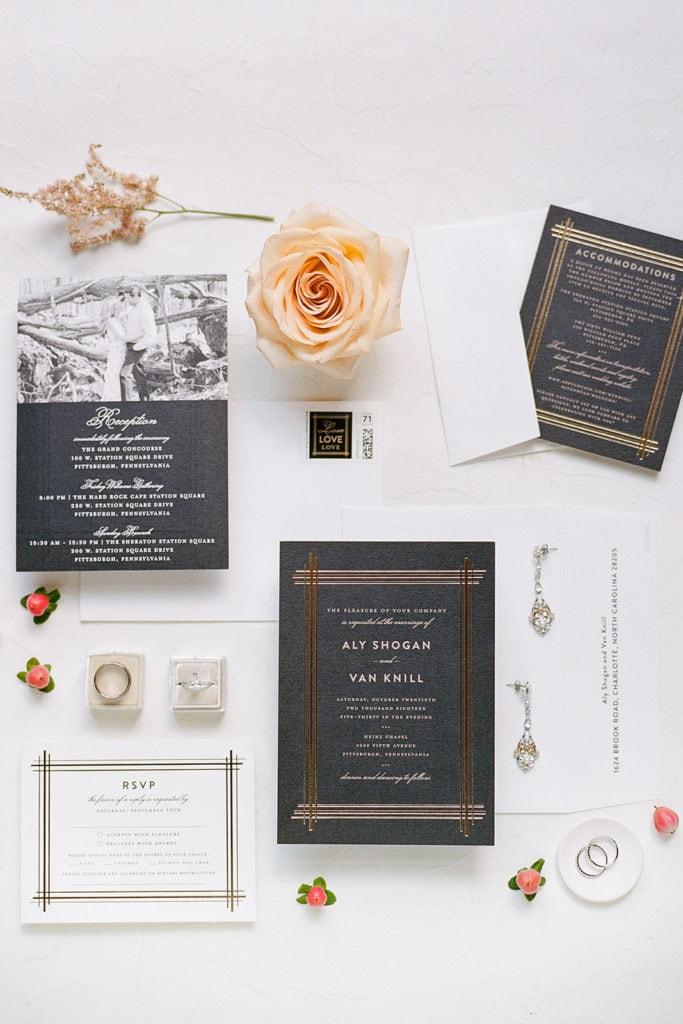 Black and gold art deco wedding stationery