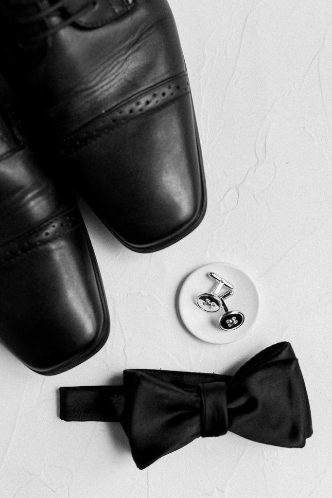 Grooms accessories with cufflinks and bow tie