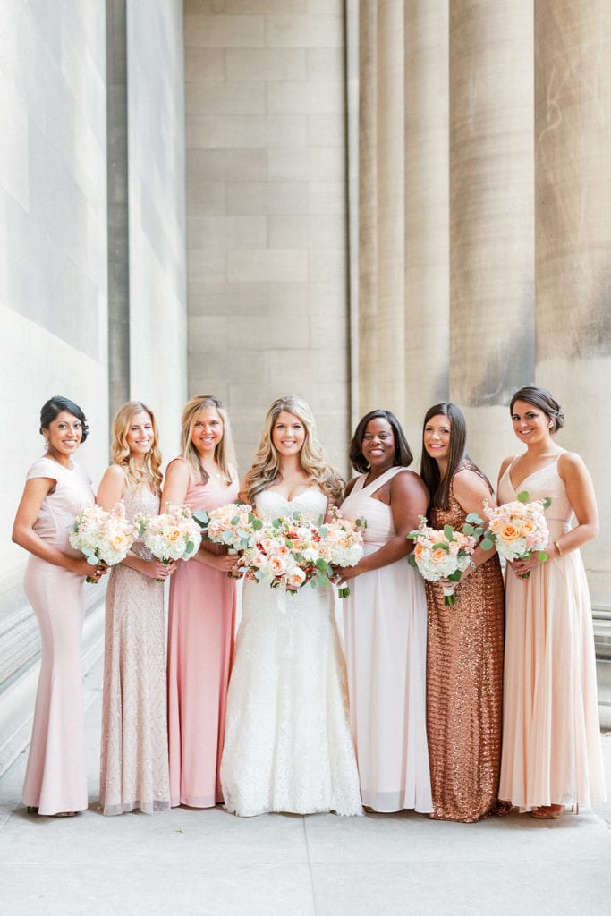 Mismatched blush and gold bridesmaids dresses