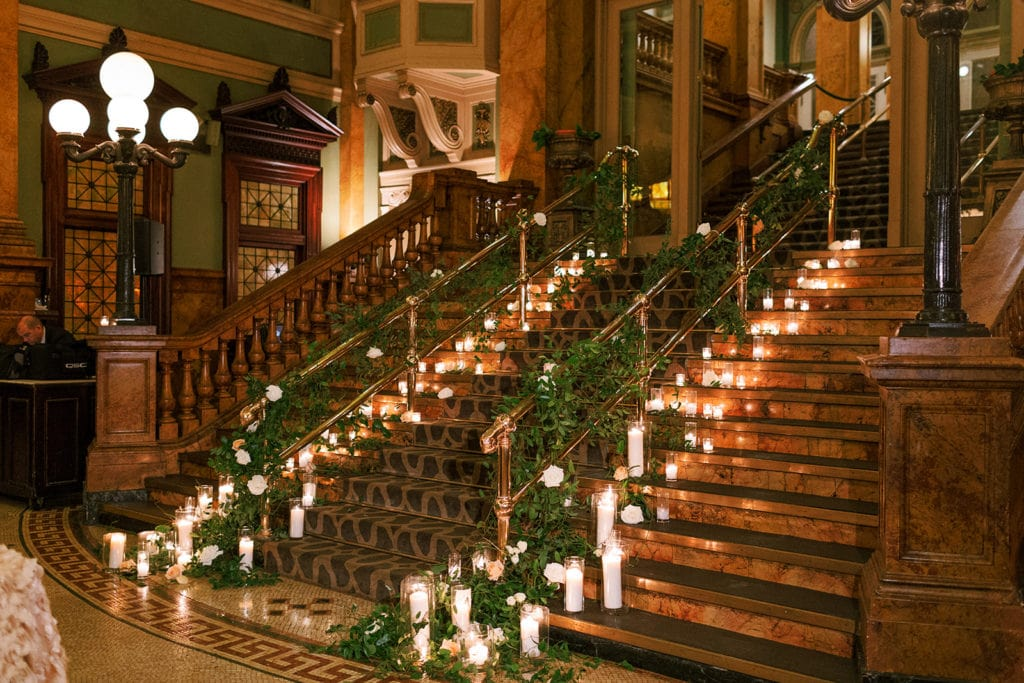 Grand Concourse stairs lined with candles and greenery for Pittsburgh Wedding
