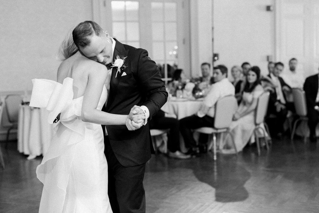 Bride and groom sharing their first dance groom putting his head on bride shoulder
