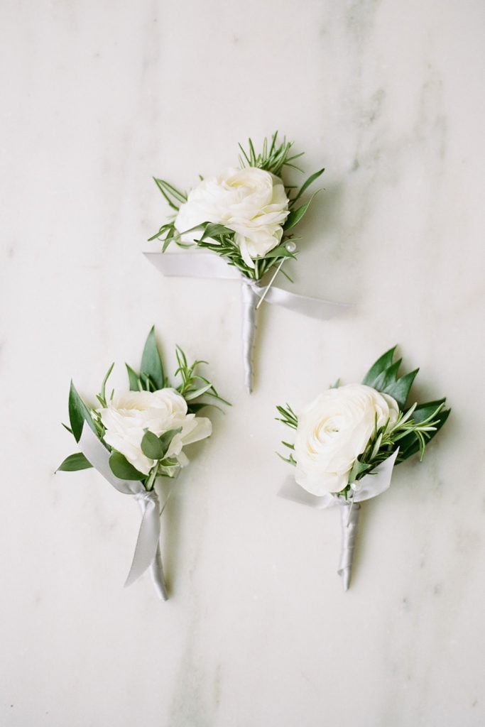 White flowers with greenery wedding boutonnieres