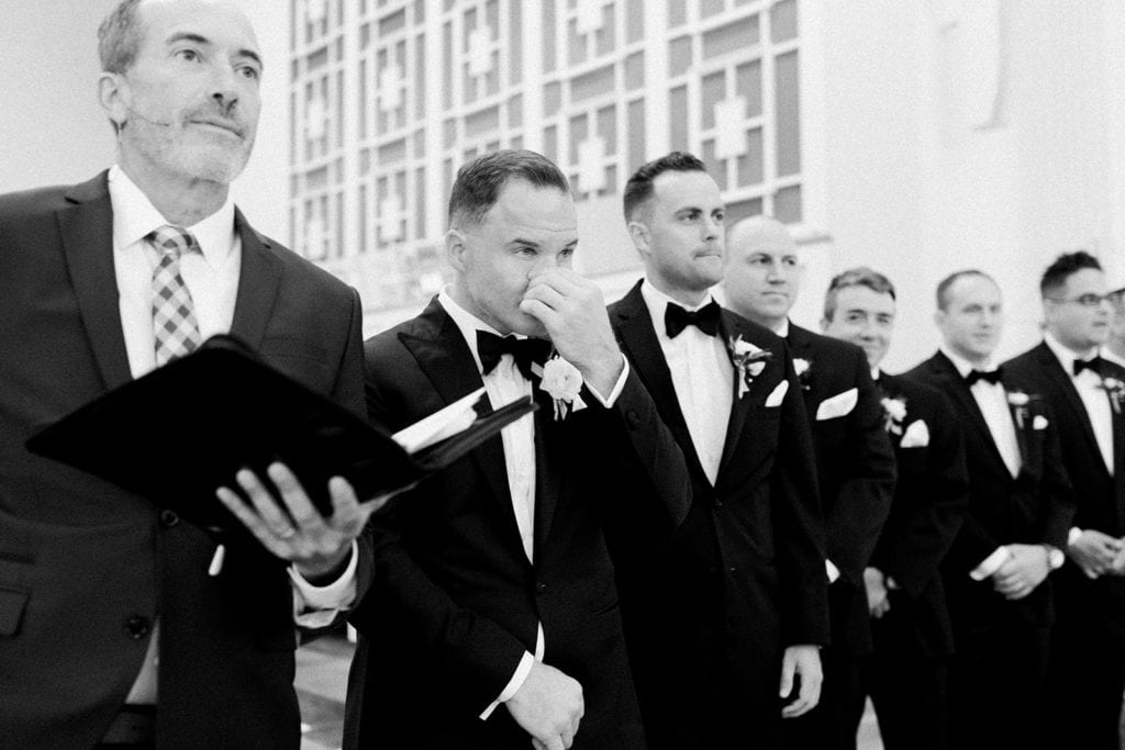 Groom's reaction to bride walking down the aisle