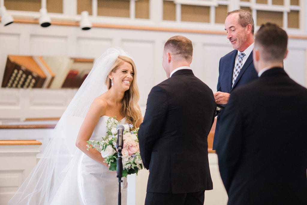 Bride and groom exchanging vows during Fox Chapel wedding