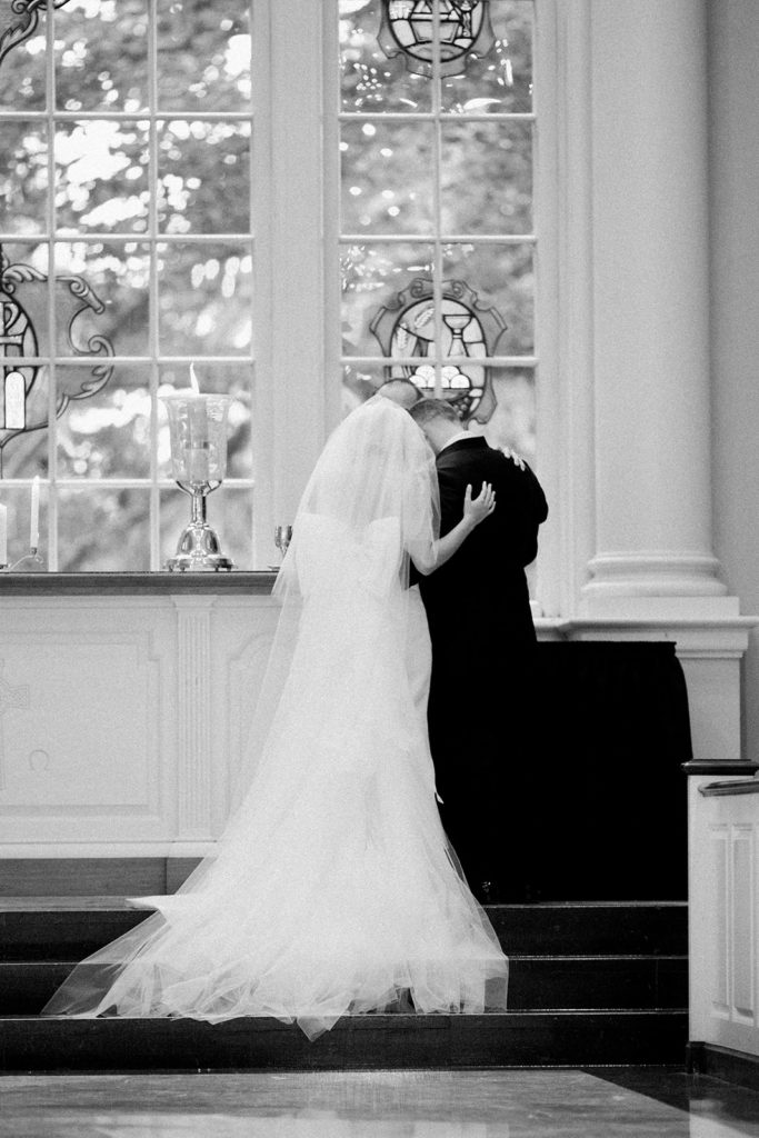 Bride and groom lighting unity candle during Fox Chapel wedding ceremony
