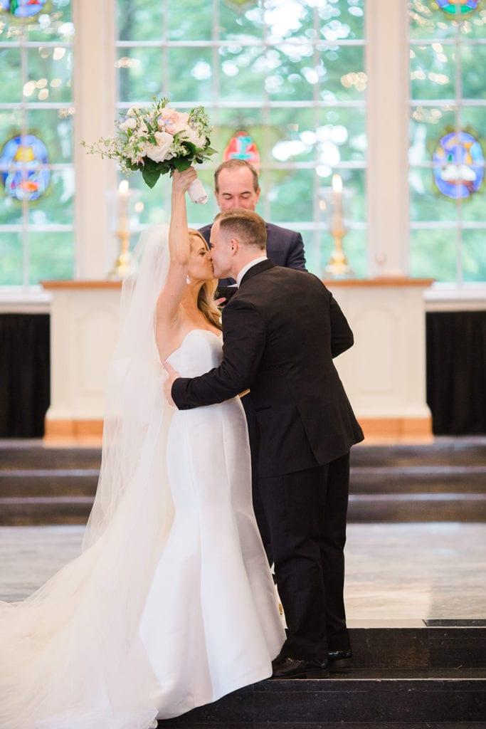 Bride and groom kissing during Fox Chapel wedding
