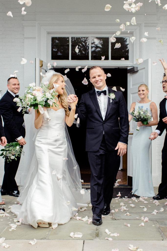 Bride and groom exit wedding ceremony