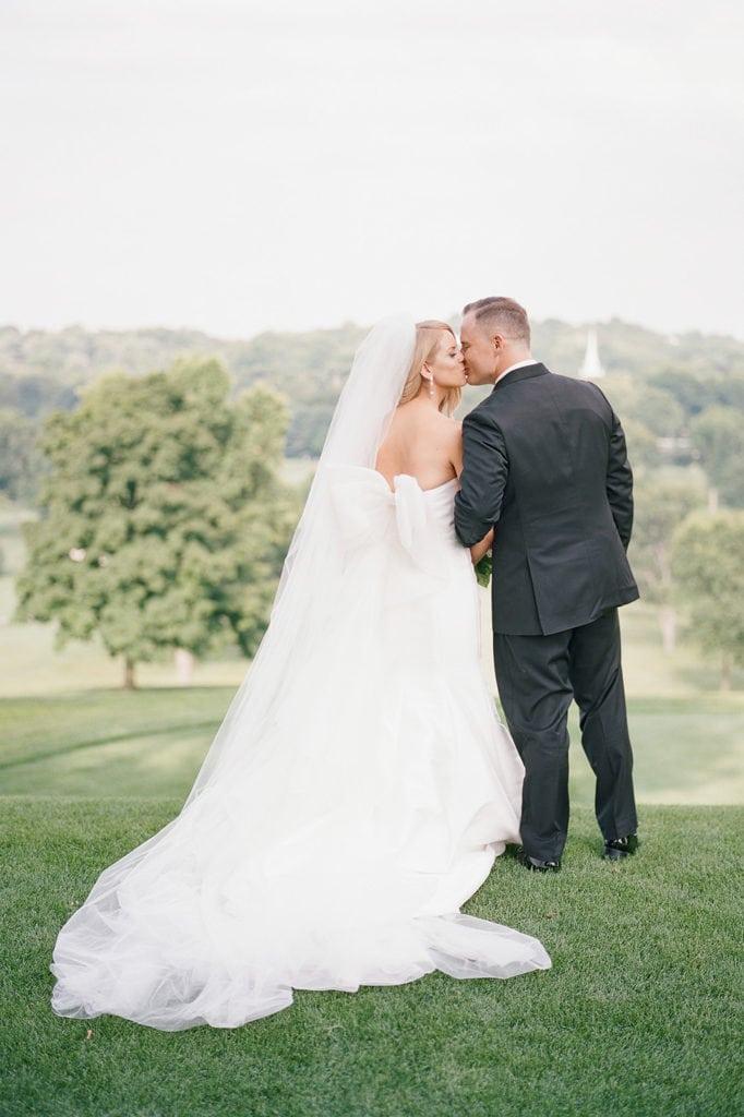 Bride and groom kissing wedding portrait