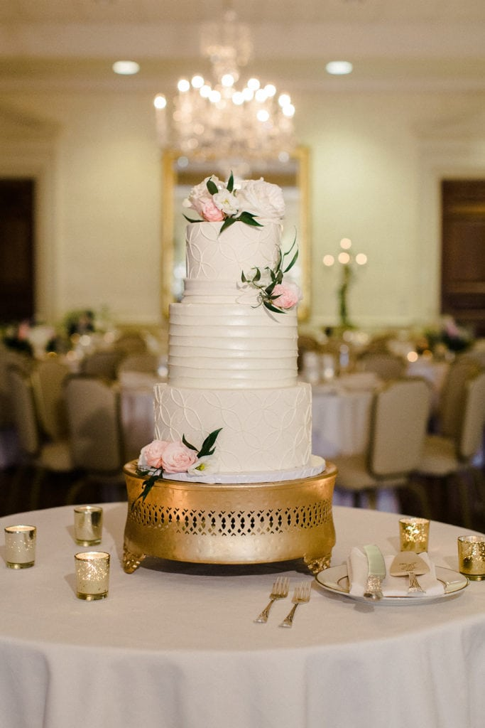 Classic white wedding cake with pink flowers