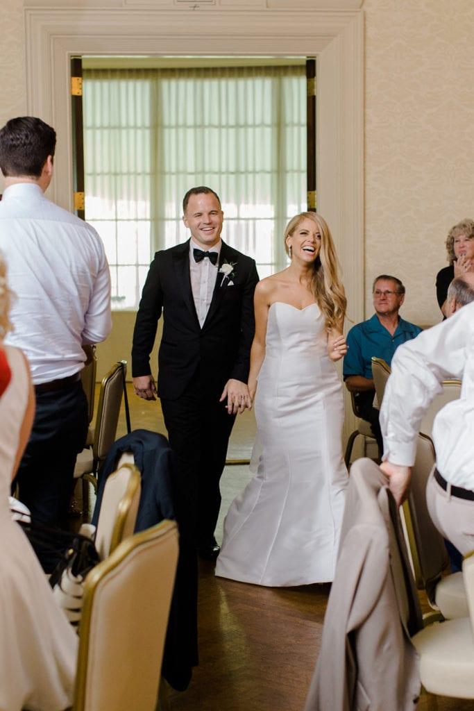 Bride and groom wedding reception entrance